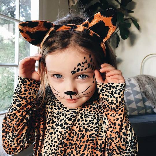 Arlo says Happy Halloween in her cheetah costume! Red Cap Cards